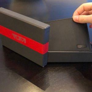 Brand new in box tumi bi-fold wallet